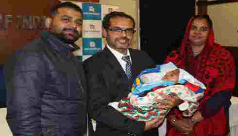Parents and doctors with the baby who had brain surgery