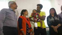 Baby Khushi with her parents and Dr Minnie Bodhanwala
